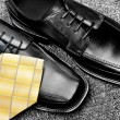Dress shoes and necktie — Stockfoto
