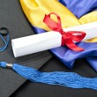 Graduation cap and diploma — Stock Photo