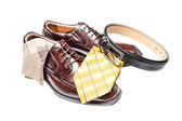Brown leather shoes with necktie — Stock Photo
