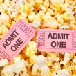 Movie tickets and popcorn - Stock Photo