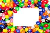 Card and jellybeans — Stock Photo