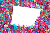 Blank invitation on confetti — Stock Photo