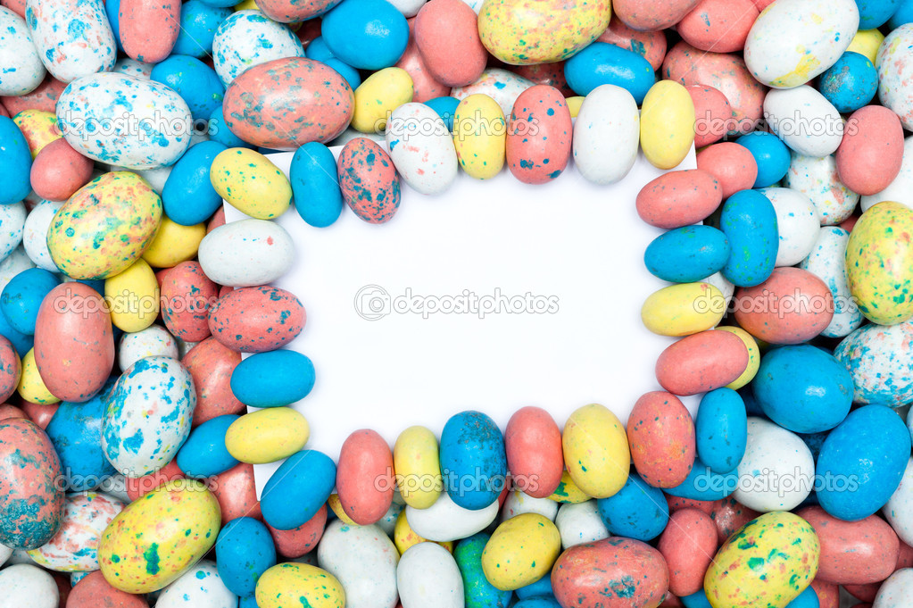 A blank message card in a pile of candy Easter eggs. — Stock Photo #9336818