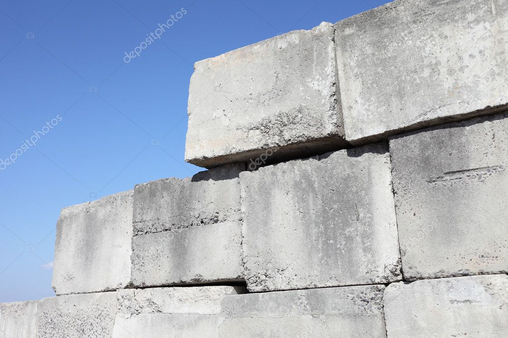 Stack of concrete blocks against a blue sky  — Stock Photo #9023750