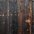 Stock Photo: Burnt wood background