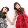 Foto Stock: Two little asian girls