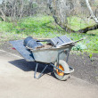 Stock Photo: Wheelbarrow with tools