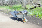 Wheelbarrow with tools — Stock Photo