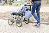 Woman and pram — Stock Photo
