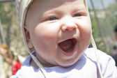 Gray eyes baby outdoors portrait close up — Stock Photo