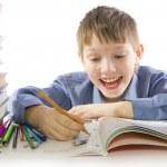 Boy making the homework — Stock Photo