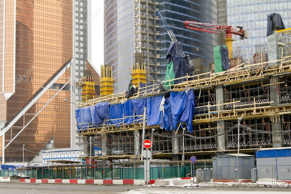 Unfinished modern skyscraper Construction site — Stock Photo #9588648