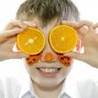 Boy with orange slices — Stock Photo