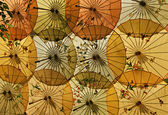 Bright chinese umbrellas in the form of decoration. — Stock Photo