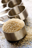 Raw Sugar in Measuring Spoon — Stock Photo