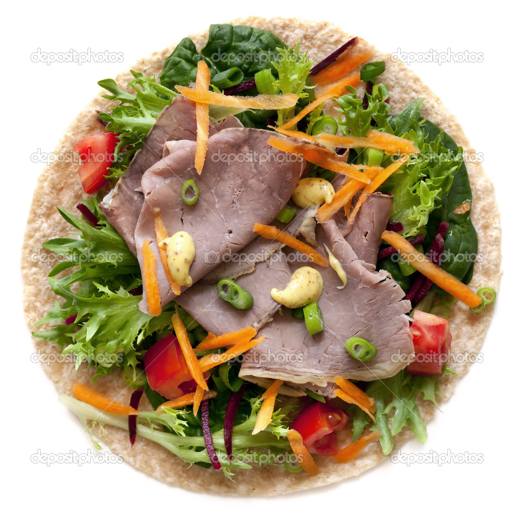 Roast beef and salad wrap with mustard, isolated on white.  Delicious, healthy eating.  Stock Photo #10381018