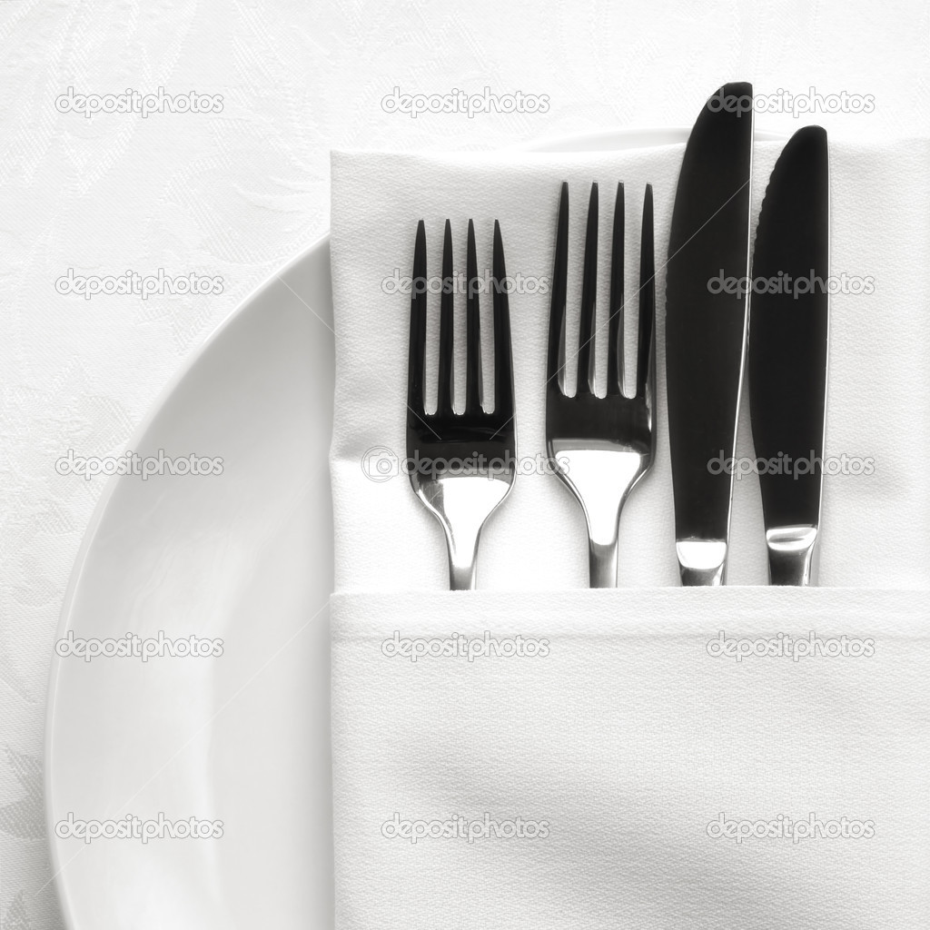 Silverware in white linen napkin, on white plate. — Stock Photo #8660480