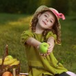 Girl with fruit in park — Stock Photo #10639751