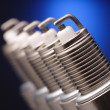 Spark plug on blue background — Stock Photo #10639798