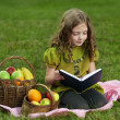 Beauty girl read book outdoors — Stock Photo #10639855