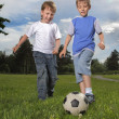 Stock Photo: Two happy boy play in soccer