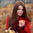 Beauty girl with apple outdoors — Stock Photo