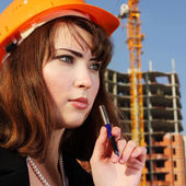 Beauty architect woman on build area — Stock Photo
