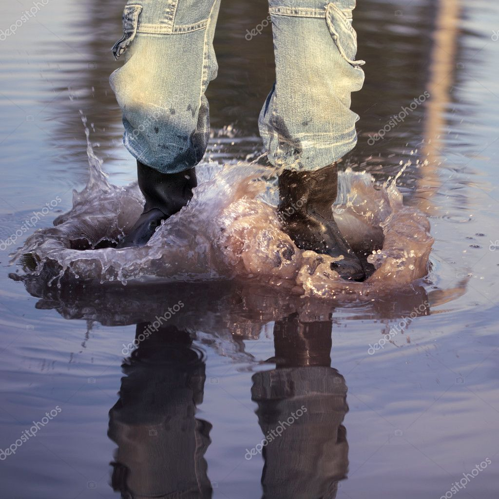 Water splash in puddle — Stock Photo #10639839