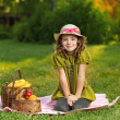 Girl with fruit in park — Stok fotoğraf