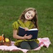 Beauty girl  read book outdoors — Stok fotoğraf