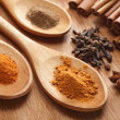 Herbs and Spices over wooden background - Stockfoto