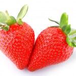 Three strawberries on white background — Stock Photo