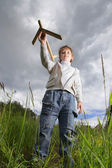 Boy play with airplane — Stock Photo