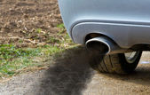 Smoking exhaust pipe — Stock Photo