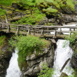 wooden bridge over saent waterfalls in the italian mountains — Stock Photo