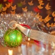 Cowboy Christmas - spur and a green ball ornament — Stock Photo