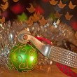 Spur and a green Christmas ball ornament — Stock fotografie