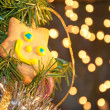 Joyous star shaped cookie in a Christmas tree — Stock Photo