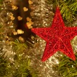 Red star ornament on Christmas wreath — Stock Photo #8002785