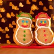 Two snowman shaped Christmas cookies standing on a red napkin — Stock Photo