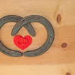 Stock Photo: Simple Valentine design with two horseshoes forming heart