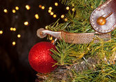 Cowboy Christmas - spur with a red ball ornament — Stock Photo