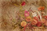 Panier d'automne fleurs sur fond texturé en sépia — Photo