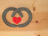Simple Valentine design with two horseshoes forming a heart — Stock Photo