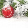 Stock Photo: Christmas wreath and red bauble with a heart in snow