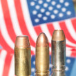 Three bullets on US flag background — Stock Photo