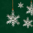 Crystal snowflake ornaments on Christmas green background — Stock Photo