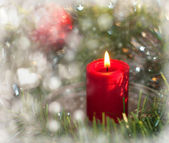 Dreamy image of Christmas candle with a wreath — Стоковое фото