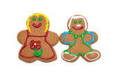 Colorful gingerbred man and woman on white — Stock Photo