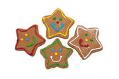 Star shaped gingerbred Christmas cookies on white background — Stock Photo